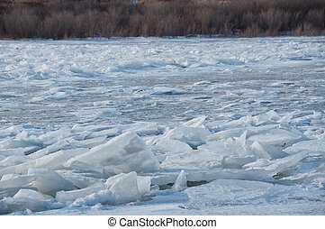 Shoreline piled with ice blocks - dangerous shoreline from ...