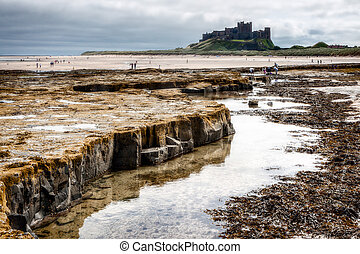 Shoreline view to Bamburgh Castle