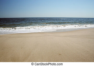 Shoreline with sand and water