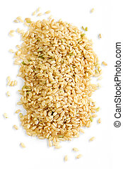 Short brown rice - Pile of short brown rice grains isolated...