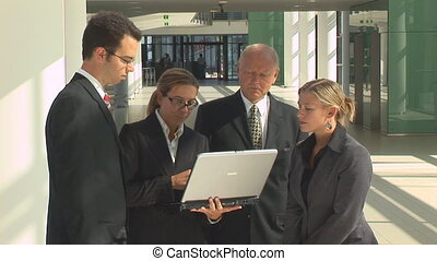 short business meeting with notebook in office building corridor, close
