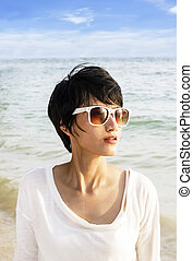 Short hair Asian woman on the beach