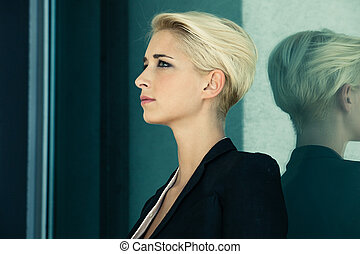short hair blonde profile - young woman with trendy short...