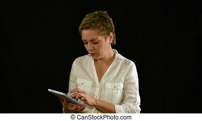 Short hair business woman texting by tablet pad