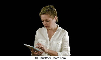 Short hair business woman texting on tablet pad