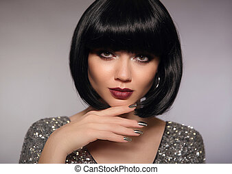 Short hair woman model. Fashion brunette close up portrait with beauty makeup, silver manicure nails and bob hairstyle isolated on gray background.