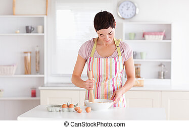 Short-haired woman preparing a cake