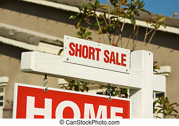 Short Sale Real Estate Sign in Front of Beautiful New Home.
