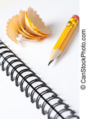 Short yellow pencil on a spriral notebook