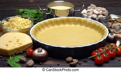 shortbread dough for baking quiche tart and ingredients in...