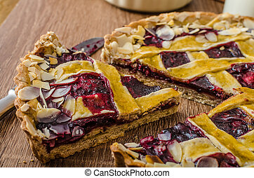 Shortbread tart with cherries, with beautiful grid, ...