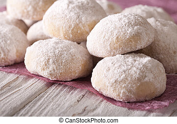 shortbread with powdered sugar close-up on a table -...