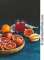Shorts of alcohol cocktail with Sliced Sicilian Blood oranges and fresh red orange juice