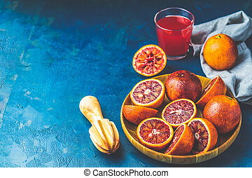 Shorts of cocktail and fresh red orange juice