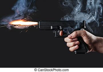 handgun - shot from a handgun with fire and smoke