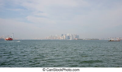 shot from the staten island ferry as it travels towards manhattan
