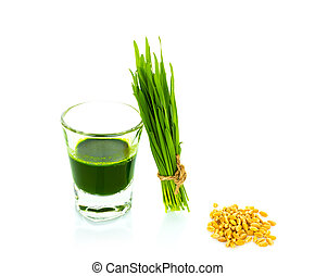 Shot glass of wheat grass with fresh cut wheat grass and...