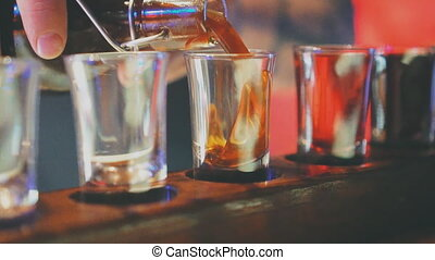 Shot glasses with liquor in the bar.