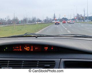 Shot inside car during driving through city