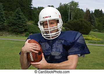 american football player - shot of a american football...