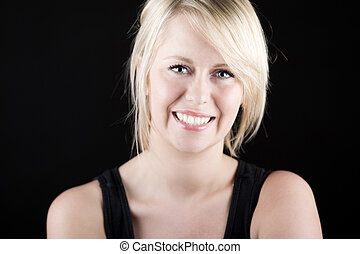 Beautiful Smiling Blonde Girl against Dark Background