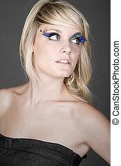 Shot of a Beautiful Teenage Girl with Feather Eyelashes