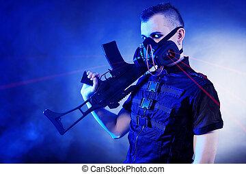 concept - Shot of a conceptual man in a respirator holding a...