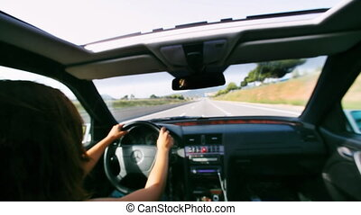 shot of a girl driving a nice car