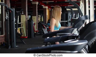 Shot of a girl running on the treadmill