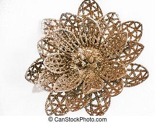 Shot of a golden flower decoration