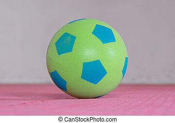 Shot of a green foam ball in a gym