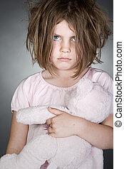 Messy Upset Child Gripping her Teddy Bear