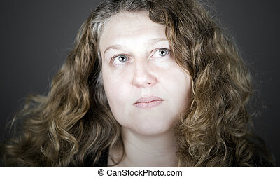 Middle Aged Woman with Long Curly Hair