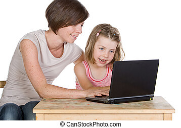 Shot of a Mother and Daughter Using their Laptop