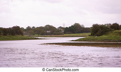Shot of a narrow river in Ireland - Landscape shot of a...
