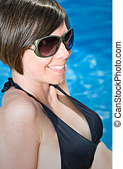 Shot of a Pretty Brunette Girl by the Pool