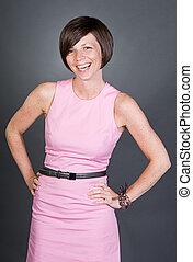 Shot of a Pretty Brunette Lady in Pink Dress