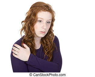 Shot of a Pretty Redheaded Teen Looking Down