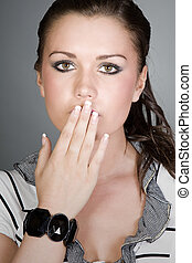 Shot of a Pretty Teen with her Hand Covering her Mouth