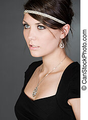 Stunning Brunette Teenager against Grey Background - Shot of...