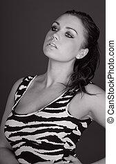 Shot of a Stunning Brunette Teenager in Zebra Print Dress