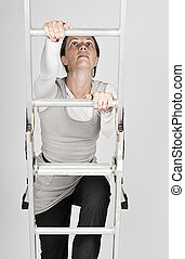 Woman Climbing a Ladder