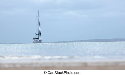 Shot of a yacht anchored near the shore - Shot of a yacht...