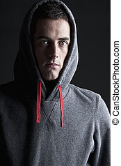 Shot of a Young Male in Hooded Top