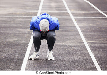 Shot of a young runner feeling bad while running outdoors.