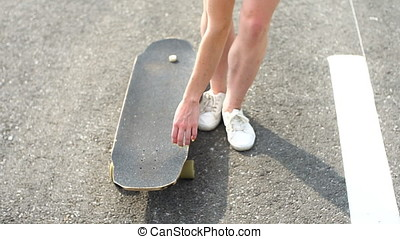 Shot of a young woman out skateboarding in the city. - Shot...