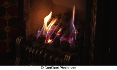 Shot of an old traditional fireplace blurring out of focus.