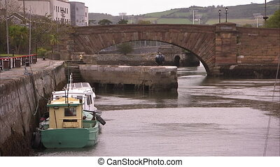 Shot of an old Irish canal with boats anchored - Shot of an...