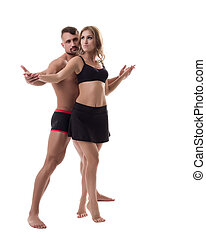 Shot of attractive athletic couple in dance pose