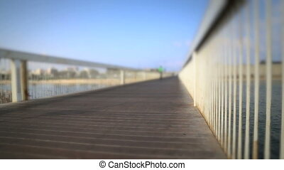 Blurred Bicycle rider on a bridge in Tel Aviv - Shot of...